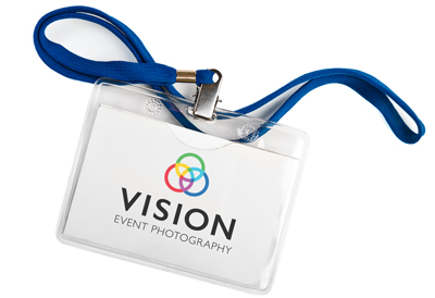 A lanyard with the Vision Event Photography logo on it.